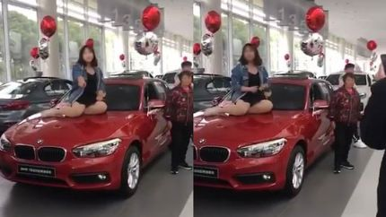 江苏宝马女车主坐引擎盖维权:事故后安全气囊未弹出